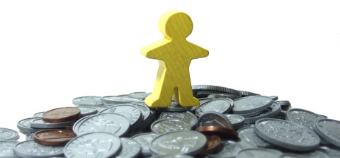 yellow man standing on a pile of money